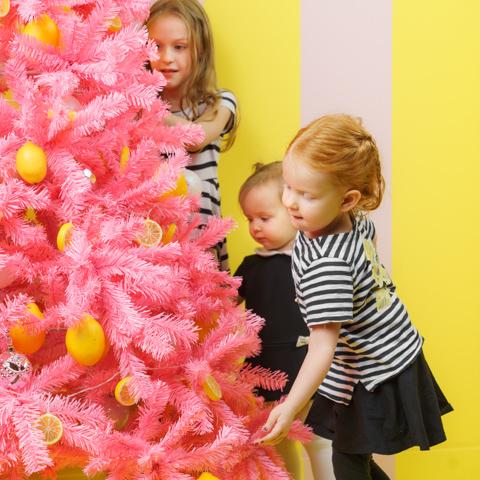 3 girls decorating lemon Christmas tree at SNAP Foto Club