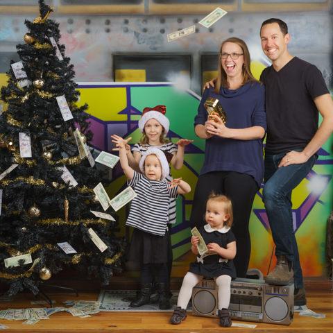 christmas family around money tree