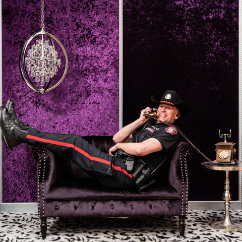 calgary police on velvet couch photography backdrop