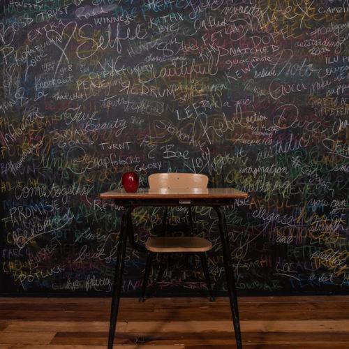 Chalk board with school desk