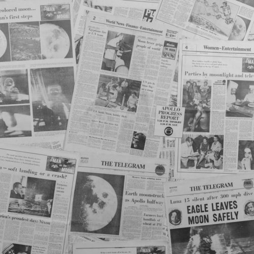 Moon landing newspapers as phtography background