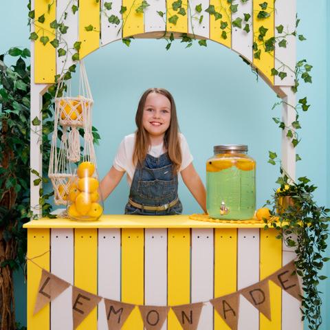 little girl selling lemonade