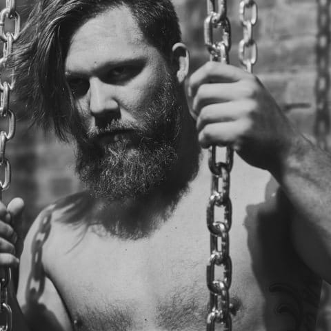 male model in chains at SNAP Foto Club
