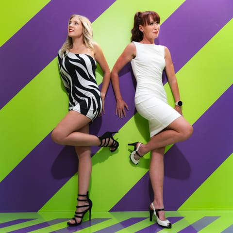 lime green and purple wall with 2 models at SNAP Foto Club
