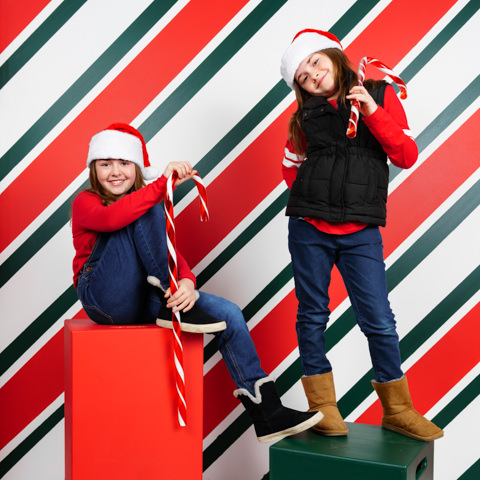 2 young girls in a candy cane background at snap foto club