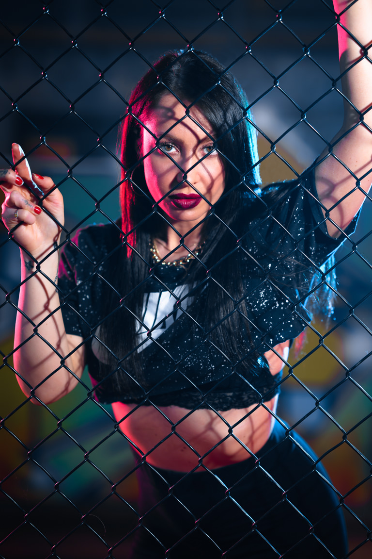 woman leaning against fence at snap foto club